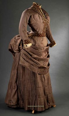 Day dress ca. 1885. Chestnut silk gros de Tours. Bodice is a faux jacket with…