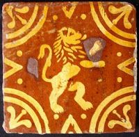 Encaustic/slipware tile with rampant lion. Made at Poperinge, West Flanders, 18th Century.