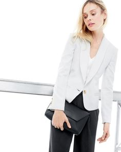 J.Crew women's cropped shawl collar blazer and leather envelope clutch. To preorder call 800 261 7422 or email verypersonalstylist@jcrew.com.