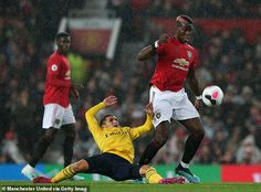 Paul Pogba of Manchester United in action with Lucas Torreira of Arsenal during the Premier League match between Manchester United and Arsenal FC at Old Trafford on September 2019 in Manchester,. Get premium, high resolution news photos at Getty Images Messi And Ronaldo, Paul Pogba, Premier League Matches, Old Trafford, Arsenal Fc, Manchester United, The Unit, Sports, Action