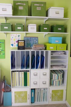 ahh, so much better to look at.  I used scrapbook paper to cover the glass doors on the unit and add a touch of color to the binders.  I also used crafting tape and clear labels with my label maker to add that pop of color that just makes me smile.