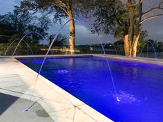Laminar jets & lighting make this pool extra special.