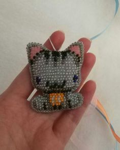 Felt kitten keychain embroidered Czech beads. It will be a great and unforgettable gift for kids and adults. Its so funnyand cute! You will love it! Kawaii kitten will take care of your keys or look after your bag! Handmade with love and care.  Size: 5,5 cm x 4,5 cm (2.17 x 1.77)  The Kitty is so nice that you will fall in love with it at first touch. But I am sure that you have already loved it…