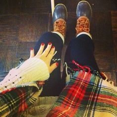 Plaid flannel, leggings, and sorels.. necessary for winters in the north