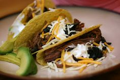A Year of Slow Cooking: Slow Cooker Shredded Beef Tacos  (also has a recipe for home made, gluten free, taco seasoning