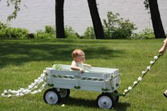 baby flower girl in painted wagon | Tuxedo & Russell's Hudson Valley June…