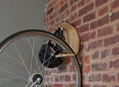 Remember the Pinch Stand? After Clankworks received a bunch of requests for a wall based bike rack, they designed the Perch. Made of bent plywood, it suspends your bike from any wall as well as sto… Bike Storage Options, Indoor Bike Rack, Bicycle Cafe, Bicycle Stand, Bike Stands, Bike Hooks, Garage Floor Paint, Bicycle Storage, Garage Remodel