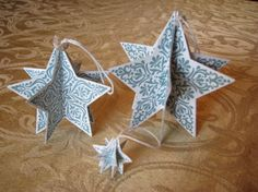 Bright & Beautiful Ornaments  by Sandy Risi, 3 sizes of the stars cut with the framelits. I used White Baker's Twine for hangers, with a little Vintage Faceted Button (hard to see). All the edges have 2-Way Glue and Dazzling Diamonds.