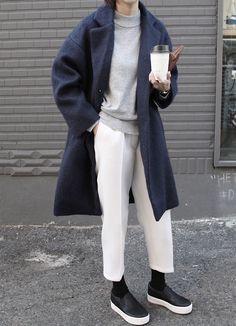 grey sweater, white bottoms, black socks, black slip ons, navy coat