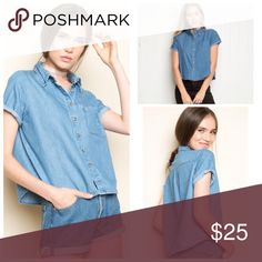 Brandy Melville Cropped Fit Denim Button-up Shirt PEYYTON DENIM/Chambray SHIRT  Size OS -Measurements approximately:52 cm width, 44 cm in length  -Small pocket on the left chest, rolled sleeves and a shirttail hem.  -100% cotton Brandy Melville Tops Button Down Shirts