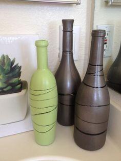 wine bottle crafts-- put string around bottle then spray paint to get that look