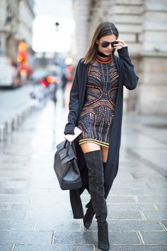 Alessandra Ambrosio in an embellished mini dress and snug knee-high boots during Paris Fashion Week.