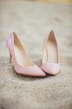 Pink heels in the sand...