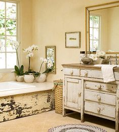 The weathered paneling on the bathtub is what REALLY does me in. It's just so beautiful, with the ordchids, the lined wicker hamper and the soft lights and all...!
