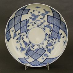 Arita c.1760 - 1800. Japanese Porcelain. An 18th Century Japanese Arita Blue and White Porcelain Dish Decorated with Flowers and Asymmetric Abstract Designs. Size: Diameter : 18.7 cm. (7 1/2 inches).