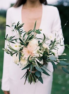 Gorgeous green and white bouquet with a hint of blush pink. The bouquet looks very natural and wild and incorporates roses, cosmos, veronica, dahlia, olive branch and eucalyptus xx