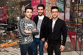 Gianluca Ginoble, Piero Barone, and Ignazio Boschetto of Il Volo visit 'Extra' at H&M Times Square on December 2, 2015 in New York City.