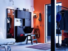 Multi-function entrance: create a functional and welcoming hallway, even where ther isn't one, with wall-mounted storage, clothes hangers and a full-length mirror.