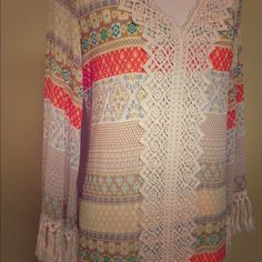 Crocheted Pastel Printed  Dress Crocheted long sleeve dress. Hits below knees. V neck crochet with detail to the hem. Tassled yarn at wrists. Size small but would fit a medium. Fully lined.  trades Entro Dresses Long Sleeve