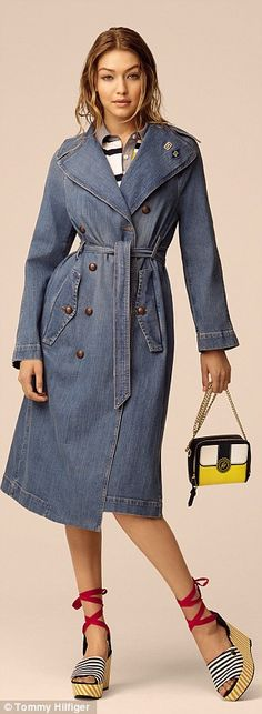 Spring collection: The model makes a denim trench look good with wet-look hair as well as a bold striped jumpsuit