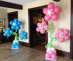 Super cute baby shower / gender reveal flower balloon columns at entrance.