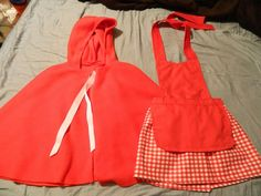 Little Red Riding Hood costume I made for Elena using tutorials from http://www.fleecefun.com/wp-content/uploads/2012/04/Fleece-Fun-Red-riding-Hood-Cape-child.pdf and http://gluesticksblog.com/2013/02/the-princess-play-apron-tutorial.html