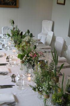 Spectacular Setting. Wild Flowers, Wild Grasses, Herbs in Vintage Bottles, Vases and Jars.