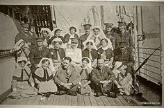 This photo was taken probably aboard a British hospital ship in Egypt toward the end of WW1. British army doctors and nurses.