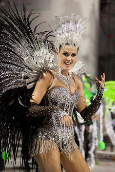 A member of the samba school Grupo Especial Vai-Vai, takes part in the parade of Carnival of Sao Paulo, at Anhembi sambodromo, in Sao Paulo, Brazil, on 17 February 2012