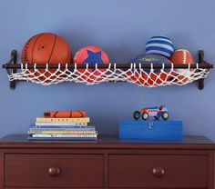 All Star Net Shelf | Pottery Barn Kids - I love this shelf and can definitely see this coming in handy down the road. I'm sure Evan is going to be a sporta fanatic just like his Daddy, and this net shelf makes it easy to store his sports balls :) It would be precious to put in his nursery and have friends and family sign footballs, soccer balls or basketballs as nice keepsakes :) #potterybarnkids
