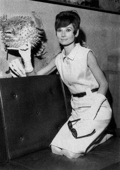 The actress Audrey Hepburn photographed at the Orly Airport (in French: Aéroport de Paris-Orly), in Paris (France), on August 23, 1965. Audrey was wearing: • Dress: Givenchy (sleeveless, of silk gabardine in a shade of pale sand, with small collar...