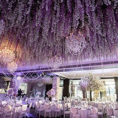 Two words to describe this wedding decor: magical and stunning! Dominated in purple with a touch of white we are having a major crush with the incorporation of hanging wisteria for extra ethereal nuance. Sprinkled with some crystal strands and glass chandelier this decor is ultra lavish exquisite and extravagant! Love this as much as we do? Show some love! Floral Design & Styling @vesnagrassofloraldesigner / Venue @navarra_venues @lemontage_navarravenues / Event Decoration @eventsbynadia…