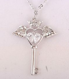 'Crown Your Heart Angel Wings Key Necklace' is going up for auction at  3am Mon, Feb 4 with a starting bid of $10.