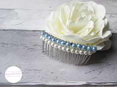 Check out this item in my Etsy shop https://www.etsy.com/uk/listing/540923388/pearl-bridal-comb-winter-wedding