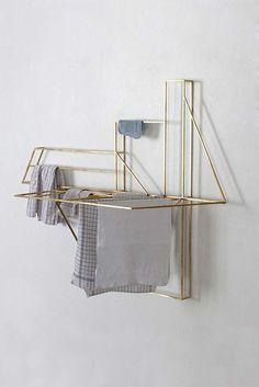 Brass laundry drying rack by Berlin's Studio Berg