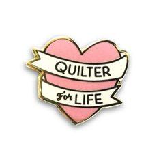 A cute quilty enamel pin!