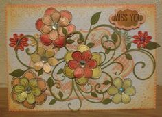 An embossed card with Distress Ink Pad marmalade orange, then a Marianne Die, A leaf die and finished off with Sheena Douglass Stamps Flowers with Aurora Borealis Gems in the centre of each flower. The flowers were painted with Sheena's H2O Paints.