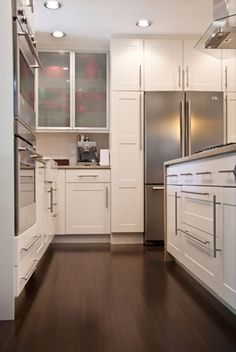 White cabinets, dark floors, brushed metal hardware