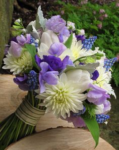 white dahlia, blue muscari, purple lisianthus, lavender sweet pea, white tulip. and lily of the valley!