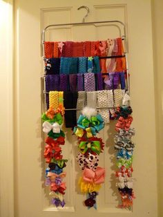 Hairband Storage solution: use a pant hanger! This is great! We have hair stuff everywhere! ----SK