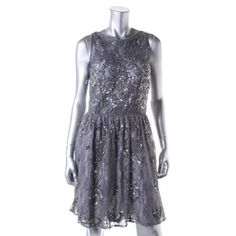 NWT*AIDAN MATTOX Purple Lace Sequined  Dress $425 Manufacturer: Aidan Mattox Size: 2 Size Origin: US Manufacturer Color: Purple/Silver Retail: $400.00 Condition: New with tags Collection: Aidan Mattox Silhouette: A-Line Sleeve Length: Sleeveless Closure: Hidden Back Zipper Dress Length: Knee-Length Total Length: 35 Inches Bust Across: 16 Inches Waist Across: 13 1/2 Inches Material: 100% Nylon/Lining:100% Polyester Fabric Type: Lace Specialty: Padded Bust Aidan Mattox Dresses