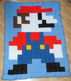 Mario blanket crochet in granny squares. So many nerdy ideas for stuff like this is piling into my head!