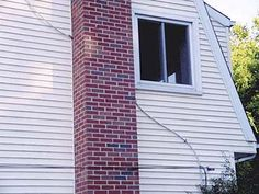 This photo shows a main exterior 100-amp electrical cable passing through a chimney in a 1968 colonial in Connecticut. The shortest distance between two points is through a chimney!   Photo: Bill Camosci | thisoldhouse.com | from Home Inspection Nightmares IV