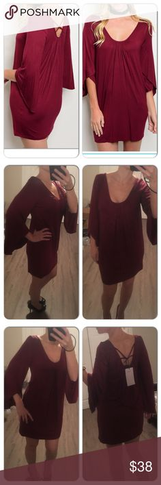 3/4 Bell Sleeve Scoop Neck Jersey Tunic Dress Wine Beautiful Wine colored Quarter bell sleeve jersey tunic dress ! Wonderful for the holidays, any occasion, Esp Valentines day !!!! great date night dress . 95%rayon 5%spandex. The dress tags say XS/S and S/M. But they run big so the XS/S is more like a regular Small. The.  S/M is more like a regular Medium Dresses Long Sleeve