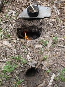 The Homestead Survival | Dakota fire hole for efficient cooking and minimal smoke signature | http://thehomesteadsurvival.com