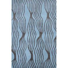 This chic and modern hand-tufted wool rug features a flowing abstract design in a soothing brown and aqua palette. Its generous size coupled with its plush 0.625-inch pile height make this rug well suited for larger living areas.