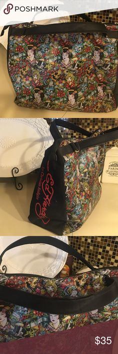 Christian Audigier Ed Hardy Overnight Tote Christian Audigier Ed Hardy Tattoo Overnight Tote. Pre-owned. Good condition little fraying on handles. Very clean. Large Ed Hardy Bags Totes