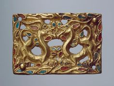 Plaque Epoch. Period: Early Iron Age Date: Sakae Culture. 4th - 3rd century BC Place of finding: Russia, Siberia Archaeological site: Siberian collection of Peter I Material: gold, turquoise and cornelian