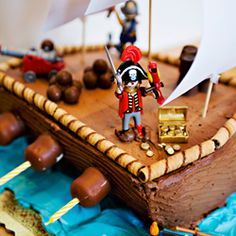 """Cute! Pirate cake - note the candles on sides as """"cannons"""". Great idea!"""