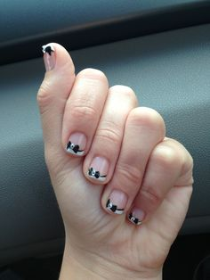 Cute gel nails with bow design and French tips!